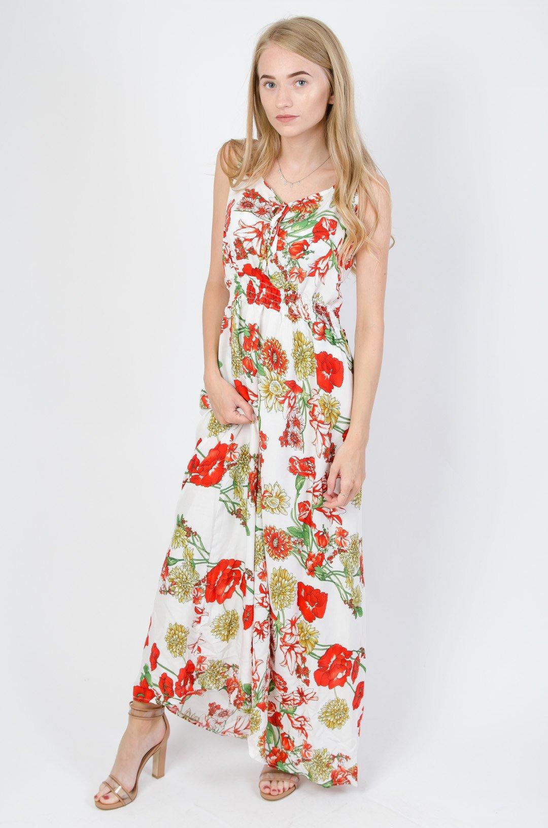 Długa biała sukienka w kwiaty wiązana w dekolcie
