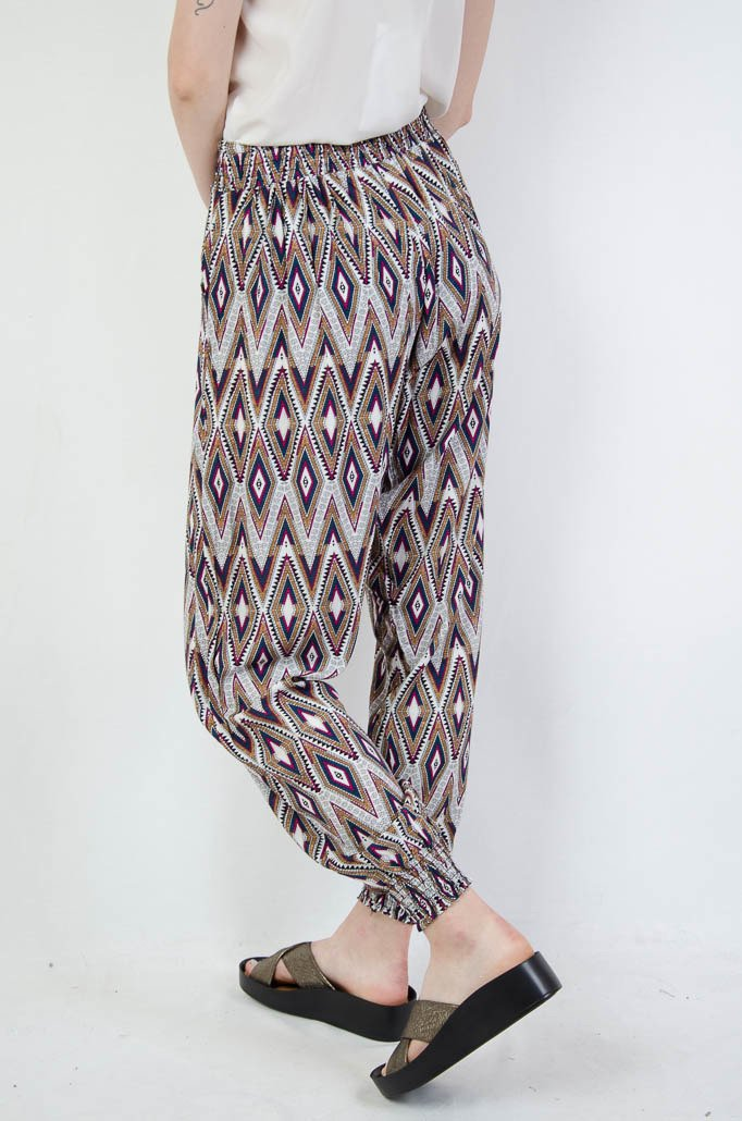 5d341f2b Spodnie alladynki w biało różowe wzory