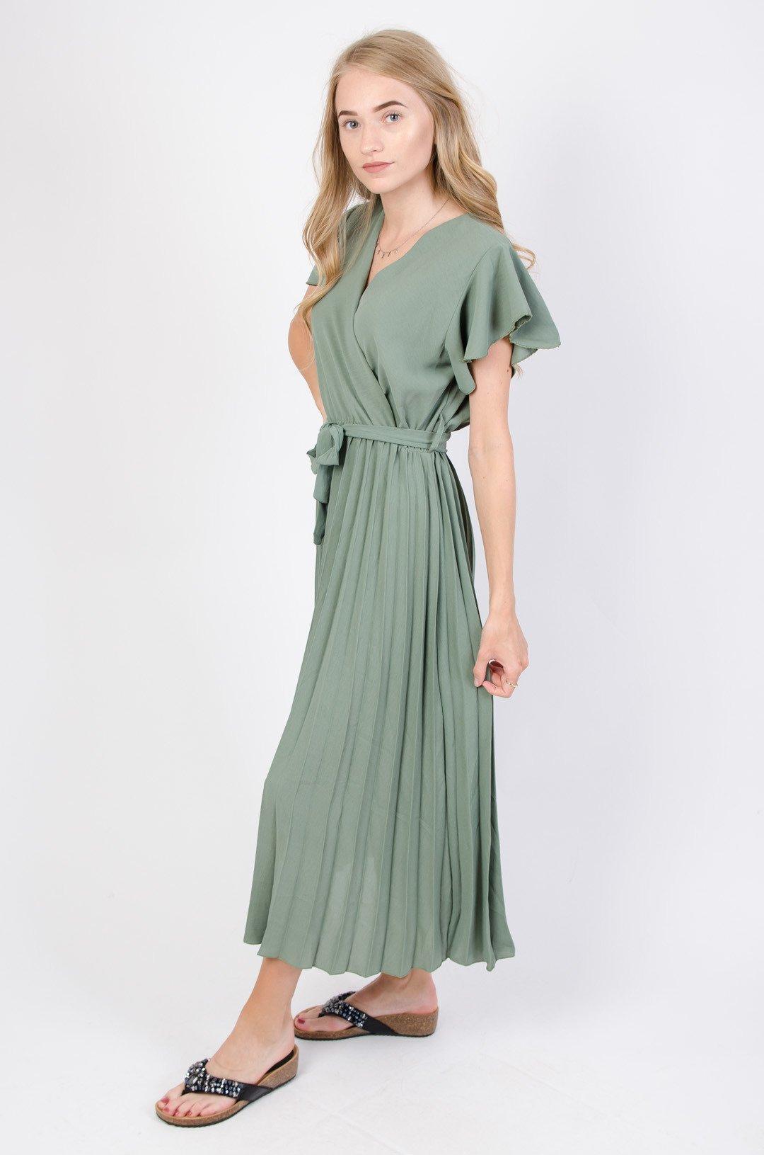długie sukienki z pisowanym dołem