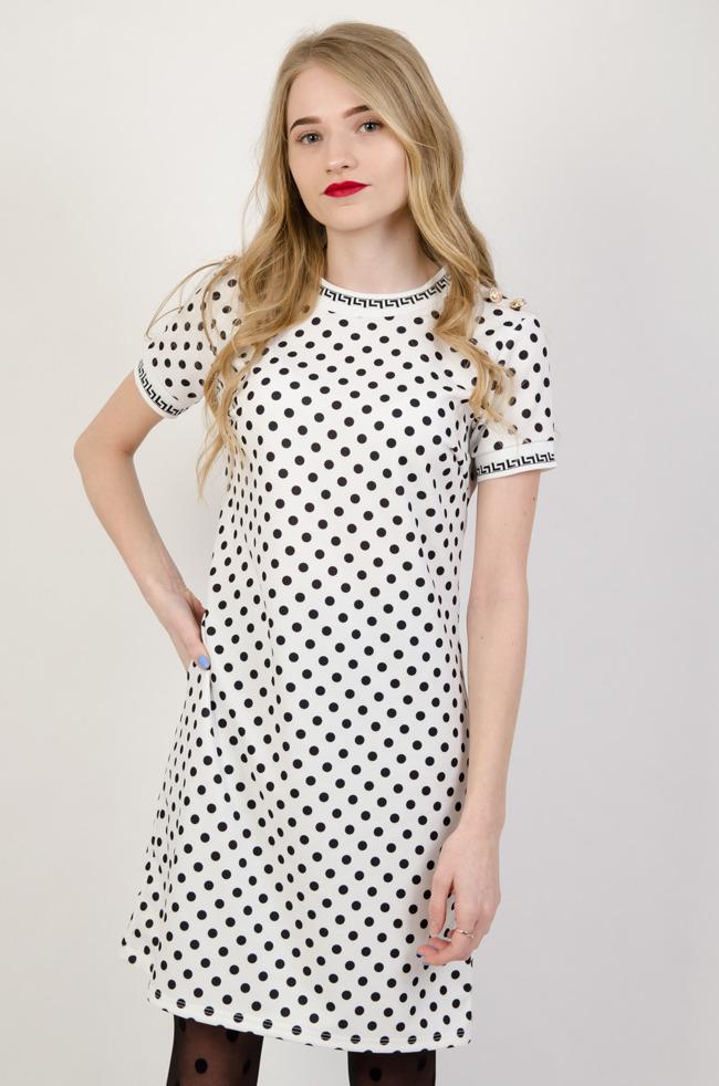 b11403a570 Biała sukienka w czarne grochy i złotymi guzikami