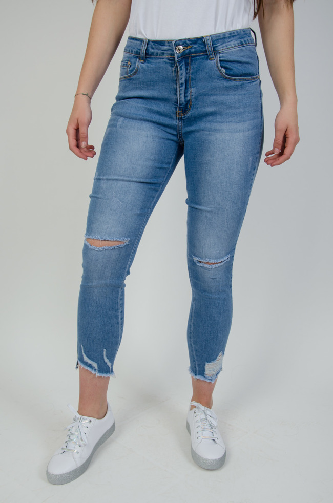a5a02c9108 Jasne spodnie jeansowe z dziurami
